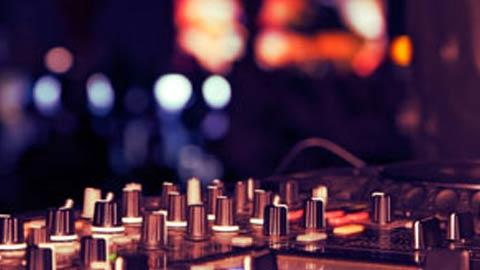 DJ equipment against a blurred club background